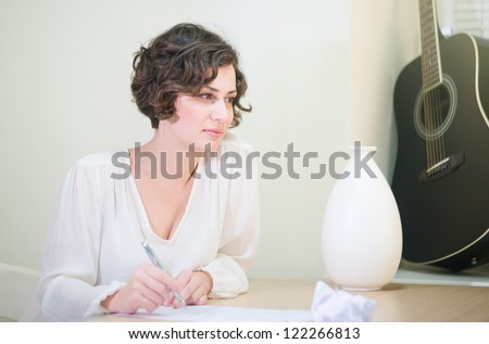 Beautiful elegant woman writing