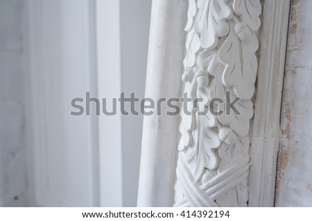 Beautiful elements of luxury wall design, white stucco mouldings over light background, antique plastering - stock photo
