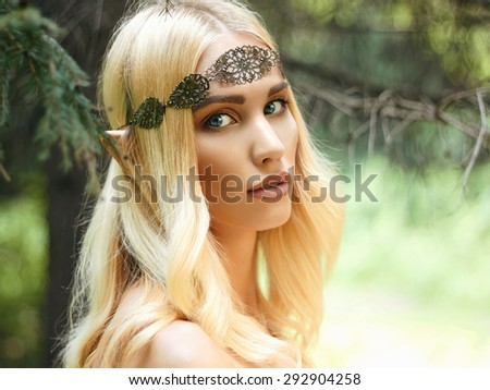 beautiful elf ears girl. fantasy young woman in woods - stock photo