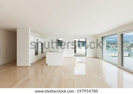 beautiful empty apartment, marble floor, modern kitchen - stock photo