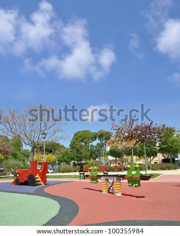 Beautiful Empty Outdoor Playground Equipment on Spring Day Blue Sky Clouds