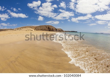 beautiful empty papagayo beaches in late afternoon sunshine - stock photo