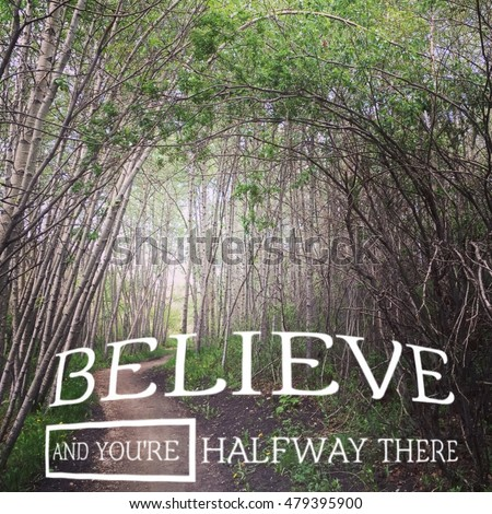 Beautiful enchanted forest with trail under bending branches.  Mystical forest Inspirational quote: Believe and you're halfway there. Instagram effects.