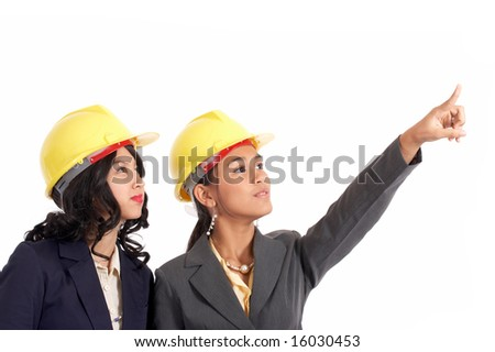 beautiful engineers working on a construction site - stock photo