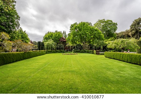 Beautiful English style garden with hedges, & symmetrical type design, with  a large open