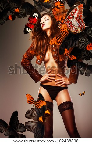 beautiful erotic sensual woman in jacket and panties with butterflies - stock photo