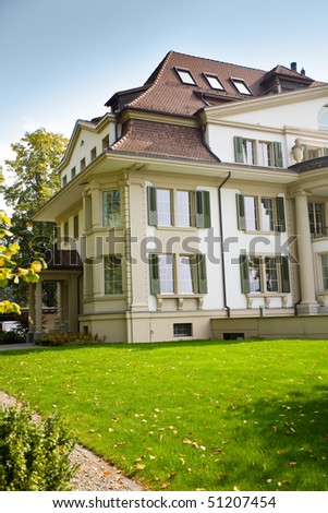 Beautiful european house with green lawn