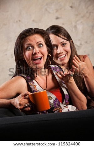 Beautiful European women with surprised reaction and laughing - stock photo
