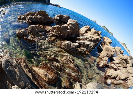 Beautiful evening landscape of rocky sea coast. Fish-eye lens. - stock photo