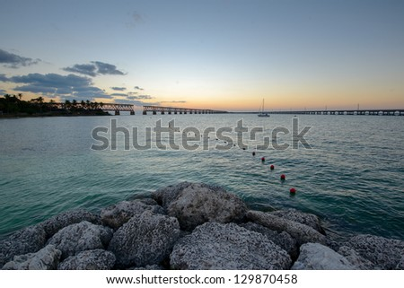 Beautiful evening landscape with two bridges across the sea - stock photo