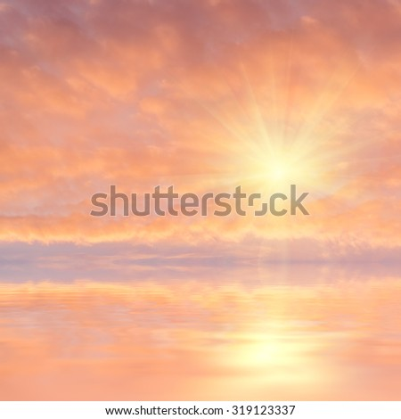 Beautiful evening sky with clouds and sun reflection in water, place for your text
