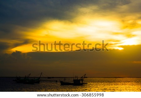 Beautiful evening  sunset above the sea with over blur boat - stock photo
