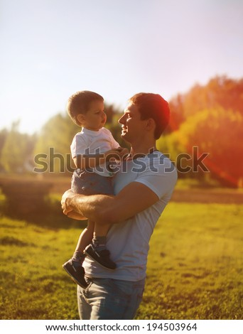 Beautiful evening sunset, happy father and son, carefree, summer, sunny photo. Sunlight on the sunset - stock photo