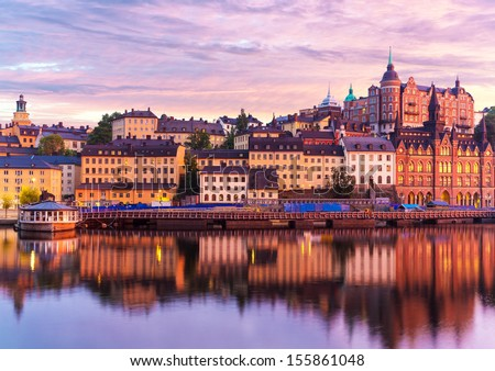 Beautiful evening sunset scenery of Sodermalm district near Slussen and the Old Town (Gamla Stan) in Stockholm, Sweden - stock photo