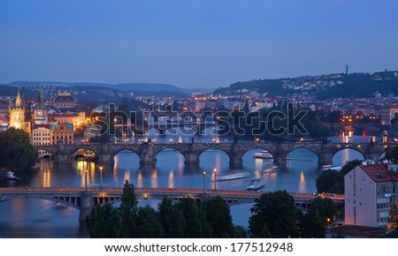 Beautiful evening view of Prague's center part with bridges above Vltava river, sunset, Czech Republic - stock photo