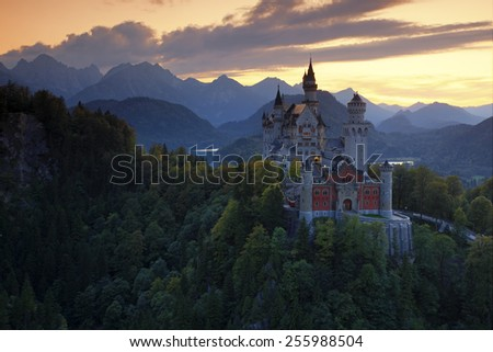 Beautiful evening view of the fairy tale Neuschwanstein castle, with autumn colours during sunset, Bavarian Alps, Bavaria, Germany - stock photo
