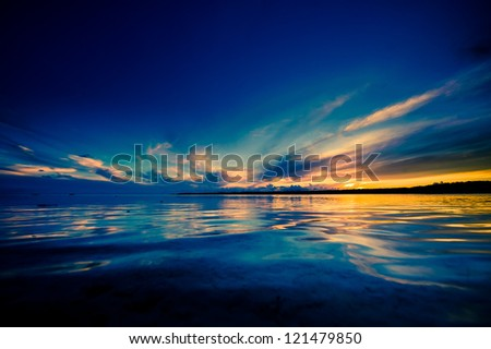 Beautiful evocative sunset reflection photographed from the water