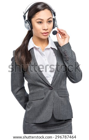 Beautiful executive asian woman in smart suit. Studio shot on white background. - stock photo