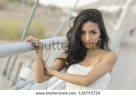 Beautiful exotic mixed race young woman with long hair - stock photo