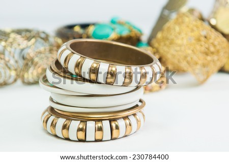 Beautiful expensive gold bracelets and ring on white background - stock photo