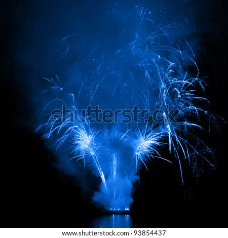 Beautiful explosions of fireworks in the night sky - stock photo