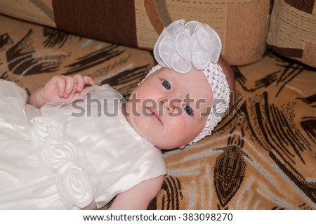 Beautiful expressive adorable happy cute laughing smiling baby infant face. Newborn child relaxing in bed. Nursery for young children. Family morning at home. smiling cute baby happy adorable child