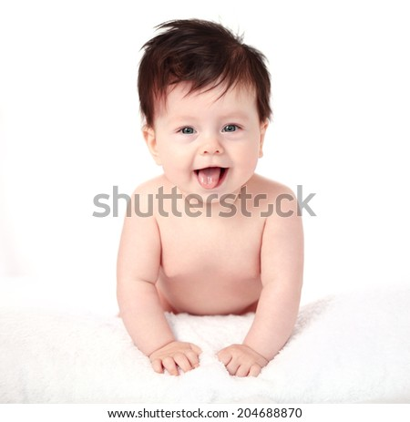 Beautiful expressive adorable happy cute laughing smiling baby infant face showing tongue, isolated.  - stock photo