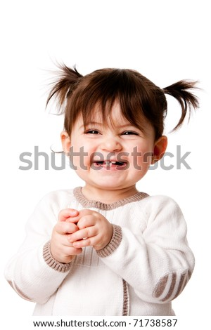 Beautiful expressive adorable happy cute laughing smiling baby infant toddler girl with ponytails showing teeth, isolated. - stock photo