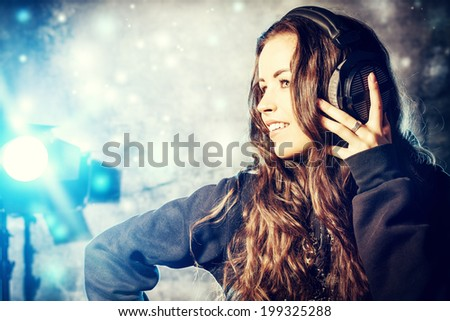 Beautiful expressive girl listening to music in headphones. Disco, party. - stock photo