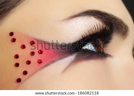 Beautiful eye with creative make-up - stock photo