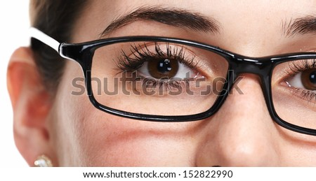 Beautiful eye with glasses close up. Isolated on white background.