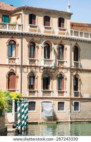Beautiful facade of typical merchant house on Grand canal, Venice - stock photo