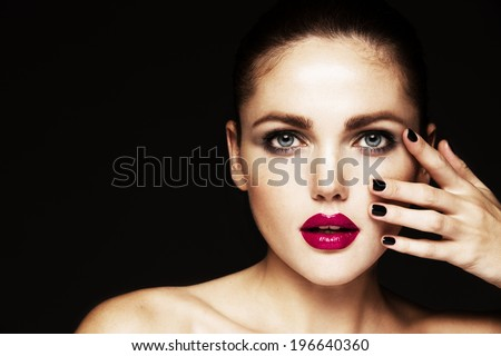 Beautiful face of a glamour woman with smoky eyes make up. Black background  - stock photo