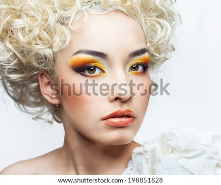 Beautiful face of a young asian girl - stock photo