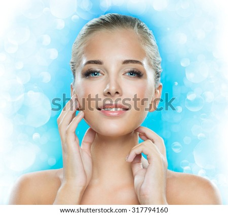 Beautiful face of a young woman - stock photo