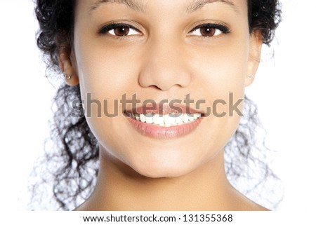 Beautiful face of an African American woman with toothy smile - stock photo