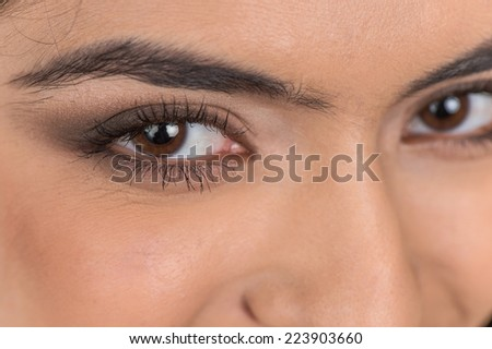 beautiful face of dark haired woman. closeup portrait of indian woman brown eyes