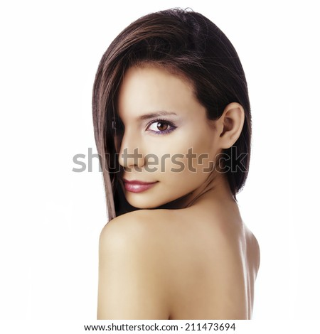 Beautiful face of gorgeous young model isolated against white background - stock photo
