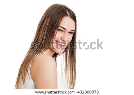 Beautiful face of smiling young girl with long straight hair in closeup isolated on white background with copyspace - stock photo
