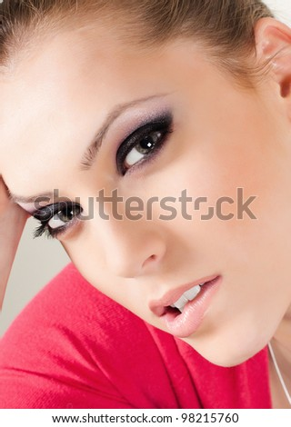 Beautiful face of the teenager girl with bright fashion make-up - on white background - stock photo