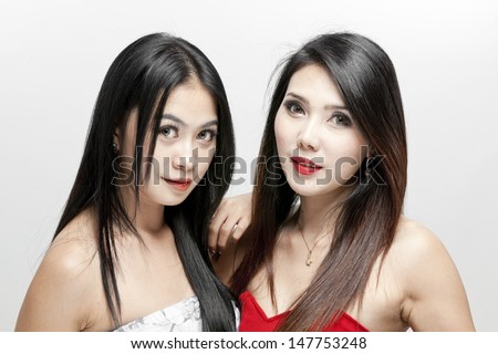 Beautiful face of two young asian woman - stock photo