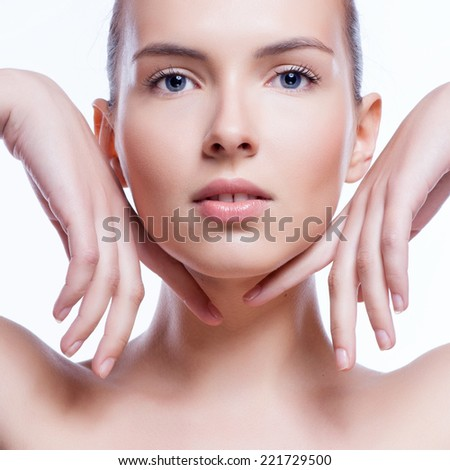 Beautiful face of young adult woman with clean fresh skin - isolated on white - stock photo
