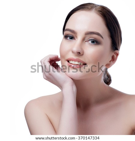 Beautiful face of young adult woman with clean fresh skin - isolated on white.  - stock photo