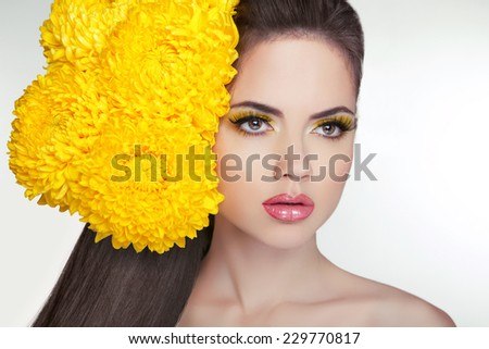 Beautiful face of young adult woman with clean fresh skin, long healthy hair. Hairstyle with flowers. Cosmetics and make-up. Girl isolated on white background.