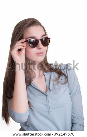 Beautiful face of young adult woman with sunglasses