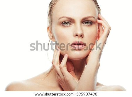 Beautiful face of young caucasian woman with natural make-up, perfect skin and green eyes isolated on white. Studio portrait. Toned - stock photo