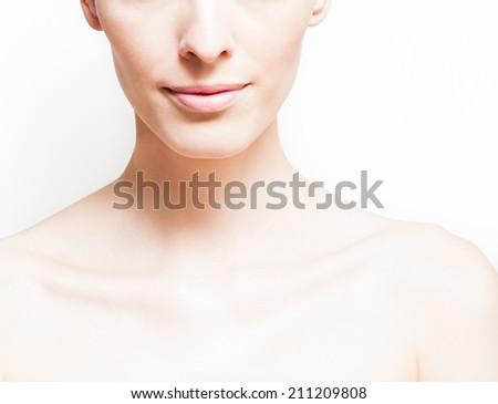 Beautiful face of young woman with clean fresh skin. - stock photo