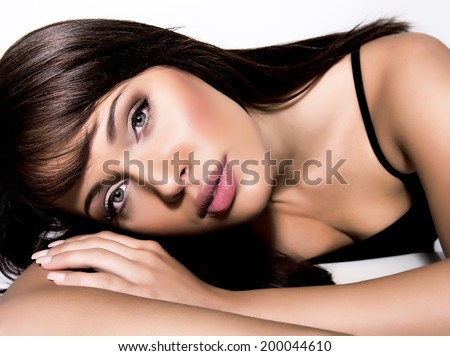 Beautiful Face of Young Woman with Clean Fresh Skin close up isolated on white - stock photo