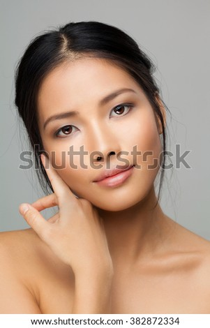 Beautiful Face of Young Woman with Clean Fresh Skin close up isolated on white. Beauty Portrait. - stock photo