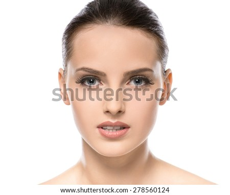 Beautiful face of young woman with clean fresh skin isolated on white background. Close-up. - stock photo